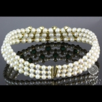 A cultured pearl, emerald and diamond set collar necklace by giovane. image 2